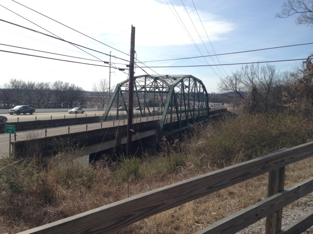 View of the steel truss bridge from the greenway