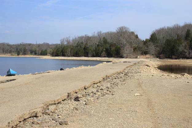Looking north of an exposed section of Old Hickory Blvd with the Big Blue Beast beached on the shoreline.