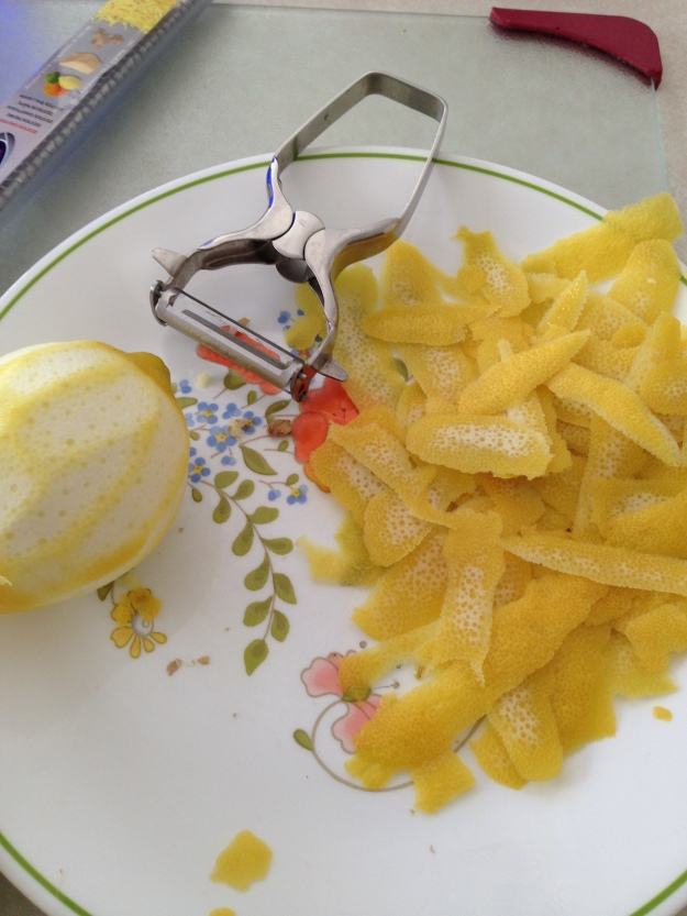 Use a peeler to carefully remove the lemon peels.